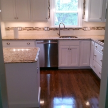 custom wood flooring with granite countertops
