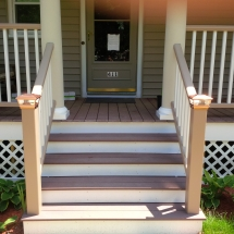 close up of steps to porch with lights on posts