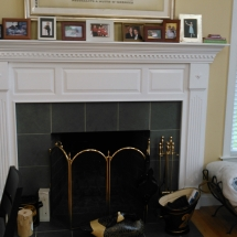 Fire place and windows with pictures