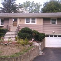 bungalow with basement garage, siding, windows, glass door