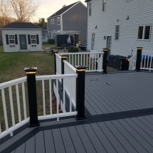 alt view on back porch with lights on posts