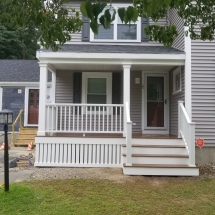 front of house porch with siding and windows and attachement