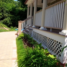 stone pathway porch with bushes