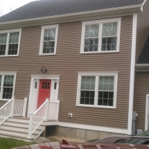 frount of house siding with doors windows garage and porch